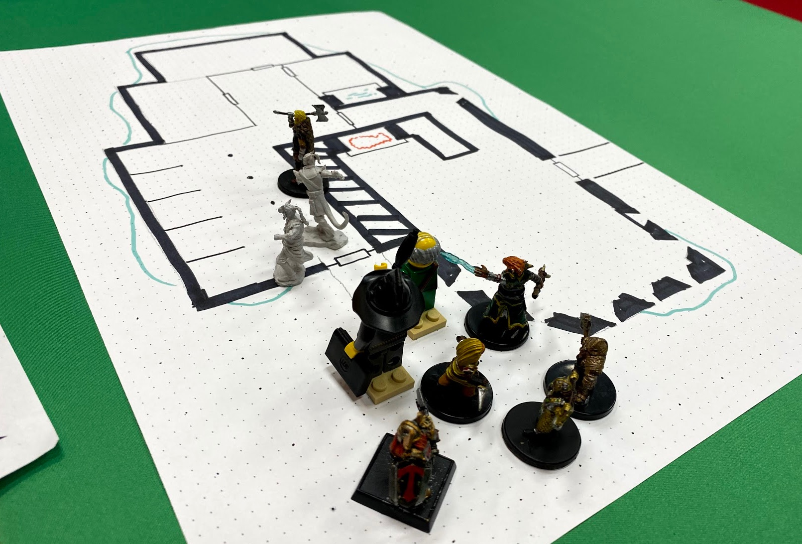 Player minis entering a dungeon